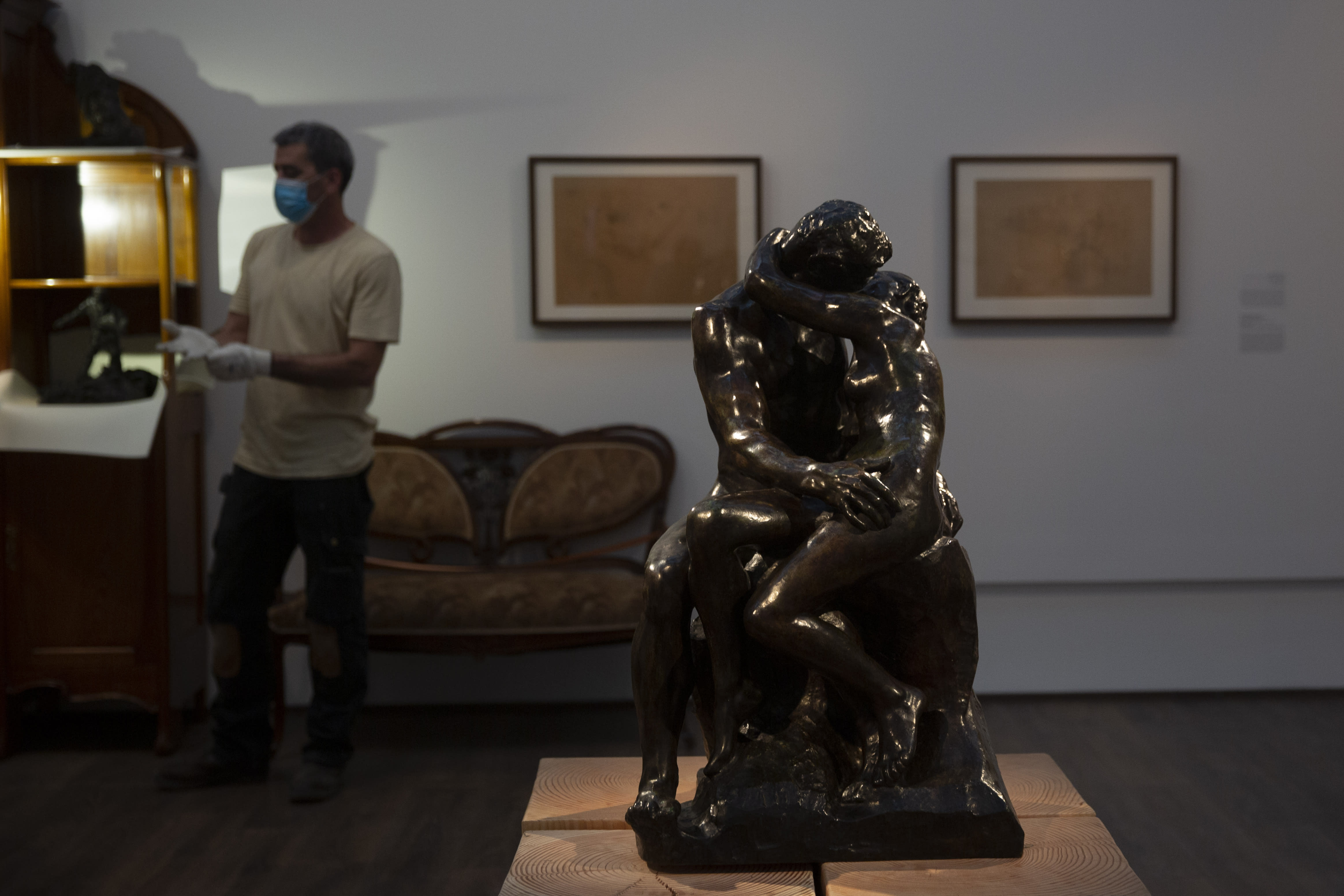 """Auguste Rodin's """"The Kiss,"""" is on display in a gallery of the Israel Museum after five months in storage during closures due to the coronavirus pandemic, in Jerusalem, Tuesday, Aug. 11, 2020. The Israel Museum, the country's largest cultural institution, is returning the priceless Dead Sea scrolls and other treasured artworks to its galleries ahead of this week's reopening to the public. (AP Photo/Maya Alleruzzo)"""