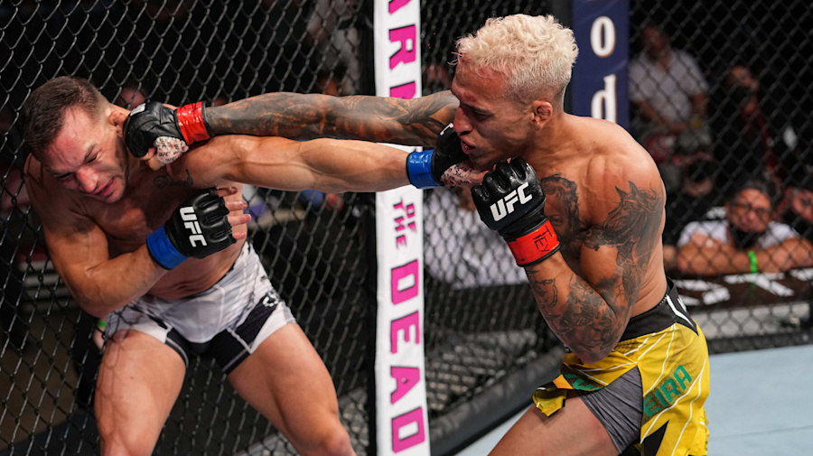 Oliveira rallies for wild UFC finish to win title