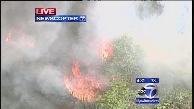 Brush fire burning in park in Lindenhurst, Long Island