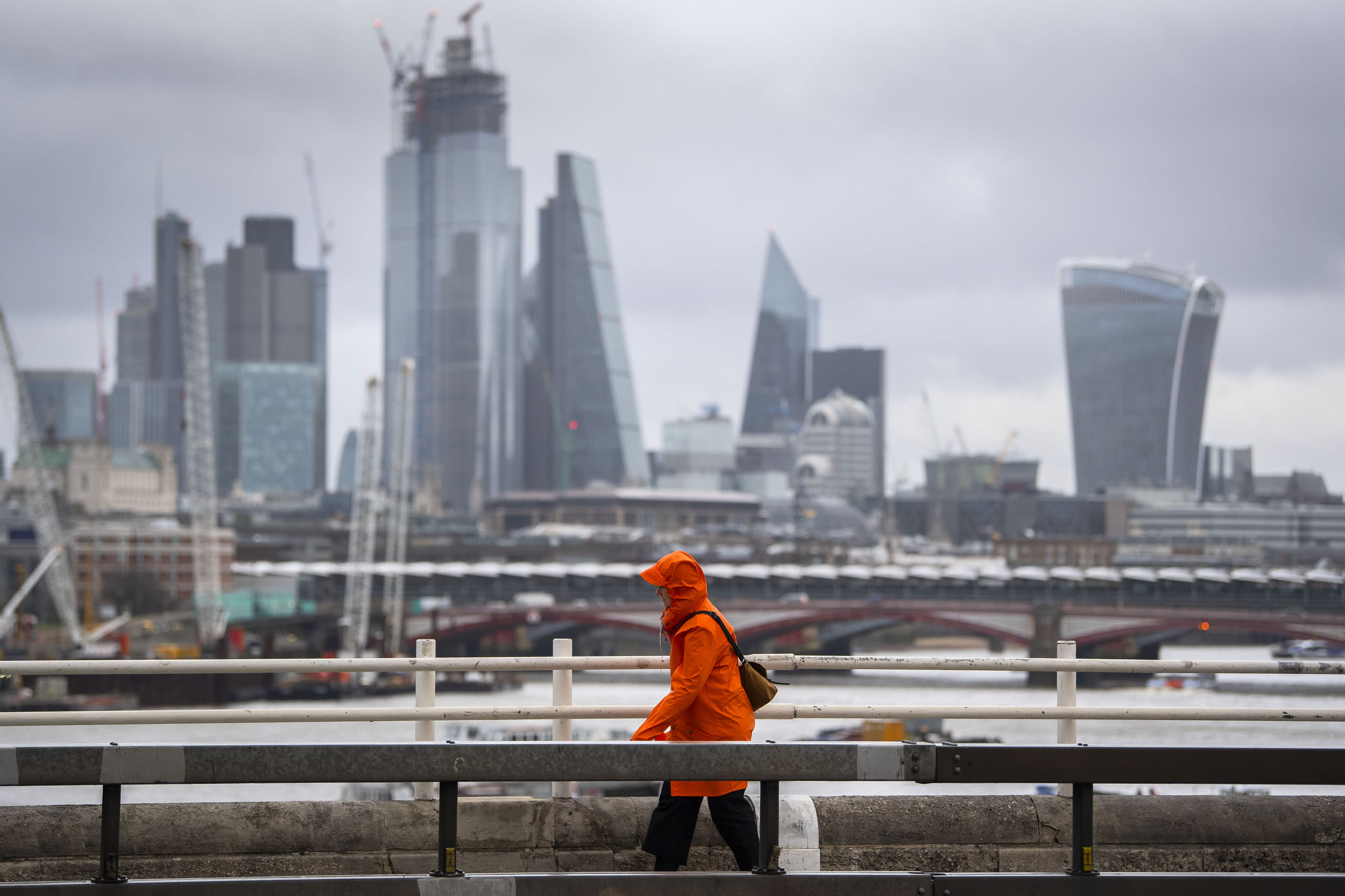 A woman battles against strong winds and rain on Waterloo Bridge in central London, as Storm Erik brought strong winds to parts of the country. (Photo by Victoria Jones/PA Images via Getty Images)