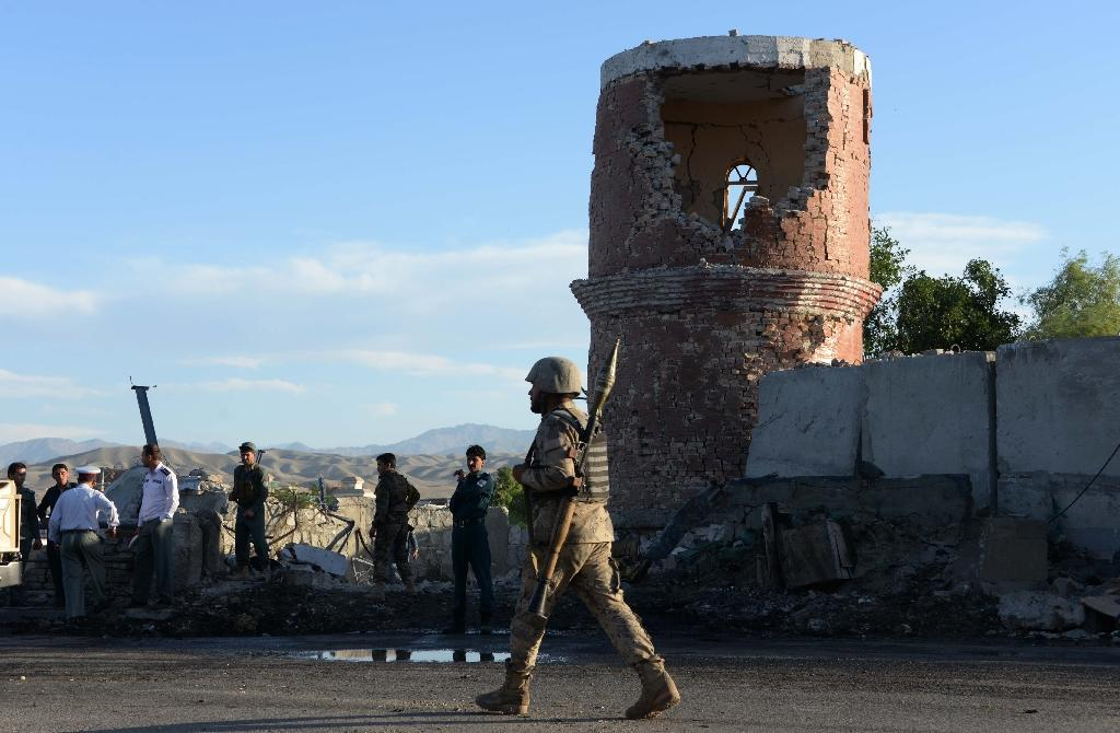 Afghan police and security inspect the site of a suicide attack targeting a police headquarters in Jalalabad, the capital of eastern Nangarhar province, on June 1, 2015 (AFP Photo/Noorullah Shirzada)