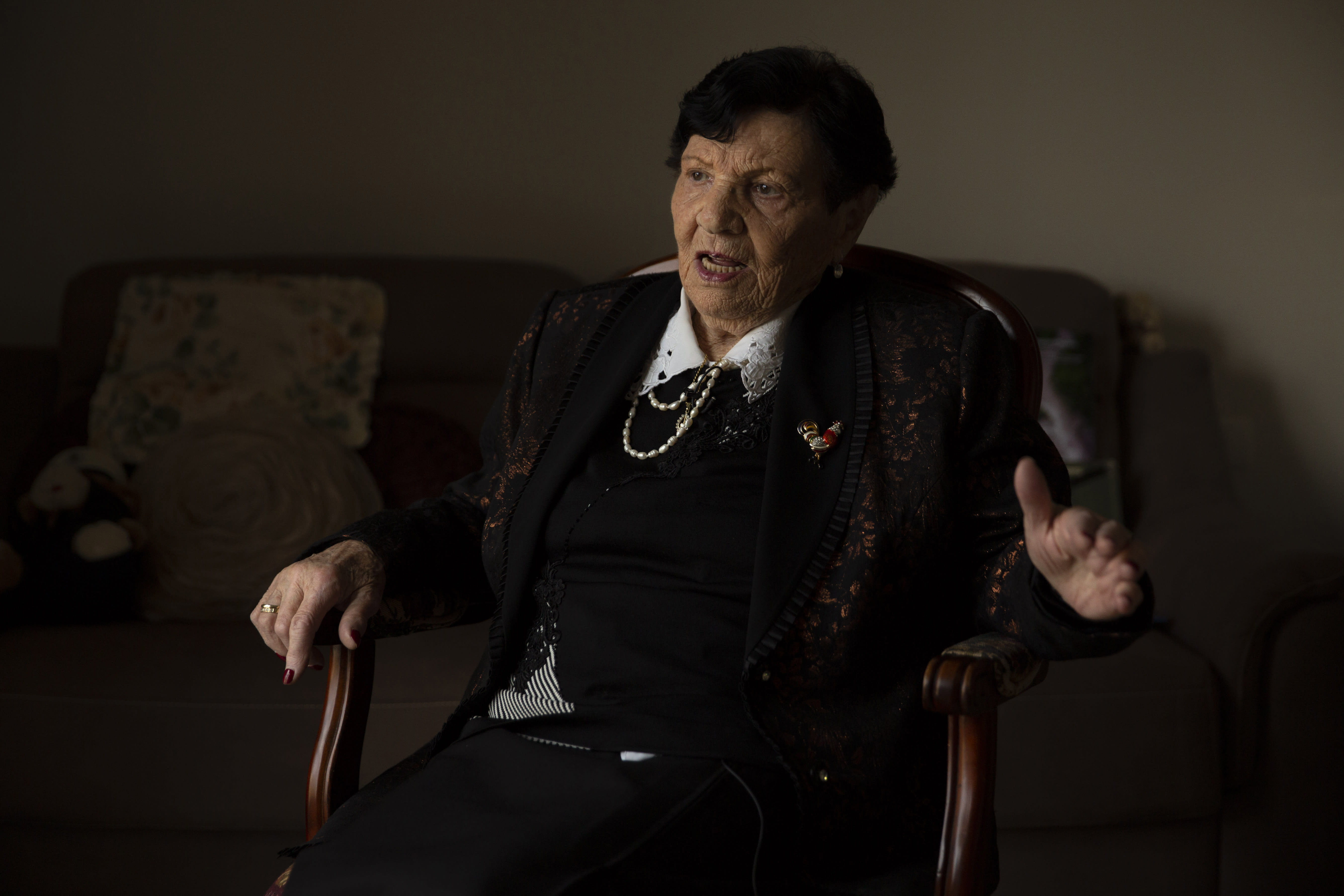 In this Wednesday, Jan. 23, 2019 photo, Holocaust survivor Cipora Feivlovich speaks to The Associated Press at her house in Jerusalem. As the world commemorates the anniversary of the liberation of Auschwitz on International Holocaust Remembrance Day, death camp survivor Feivlovich marks her own personal milestone as she turns 92. She's spent her most recent birthdays recounting to audiences in Israel and Germany her harrowing experiences in the infamous camp, where her parents, brother and best friends all perished. (AP Photo/Sebastian Scheiner)
