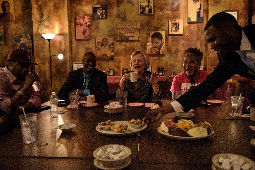 Democratic presidential nominee Hillary Clinton speaks with African American community leaders at Mert's Heart & Soul restaurant in Charlotte, North Carolina on October 2, 2016 (AFP Photo/Brendan Smialowski)