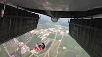 Skydivers dropped from B-17 Flying Fortress