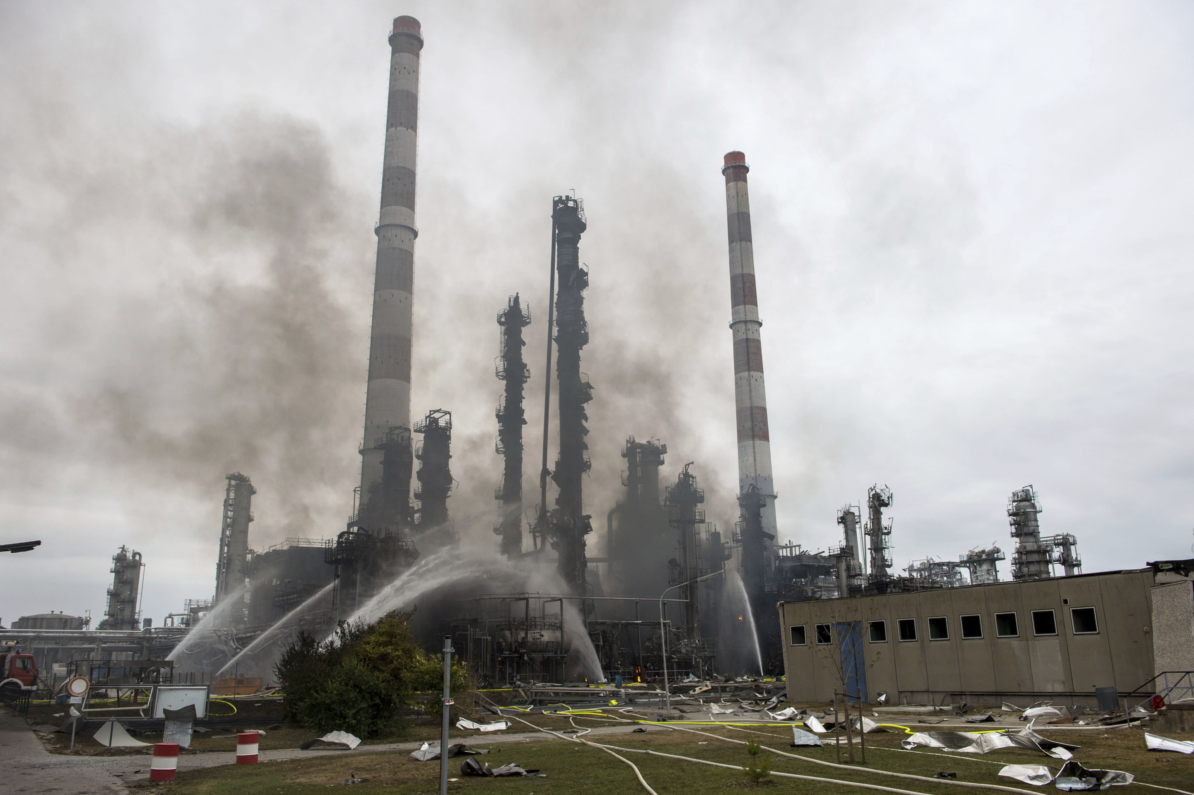Some rises over the area of a Bayernoil refinery in Vohburg an der Donau near Ingolstadt, southern Germany, Saturday, Sept. 1, 2018 after a fire broke out. (Lino Mirgeler/dpa via AP)
