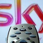Auction winner Comcast scrambles to buy Sky shares as Fox stays silent on its stake
