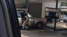 Sweet Photo of Elderly Man Feeding Wife Ice Cream Goes Viral