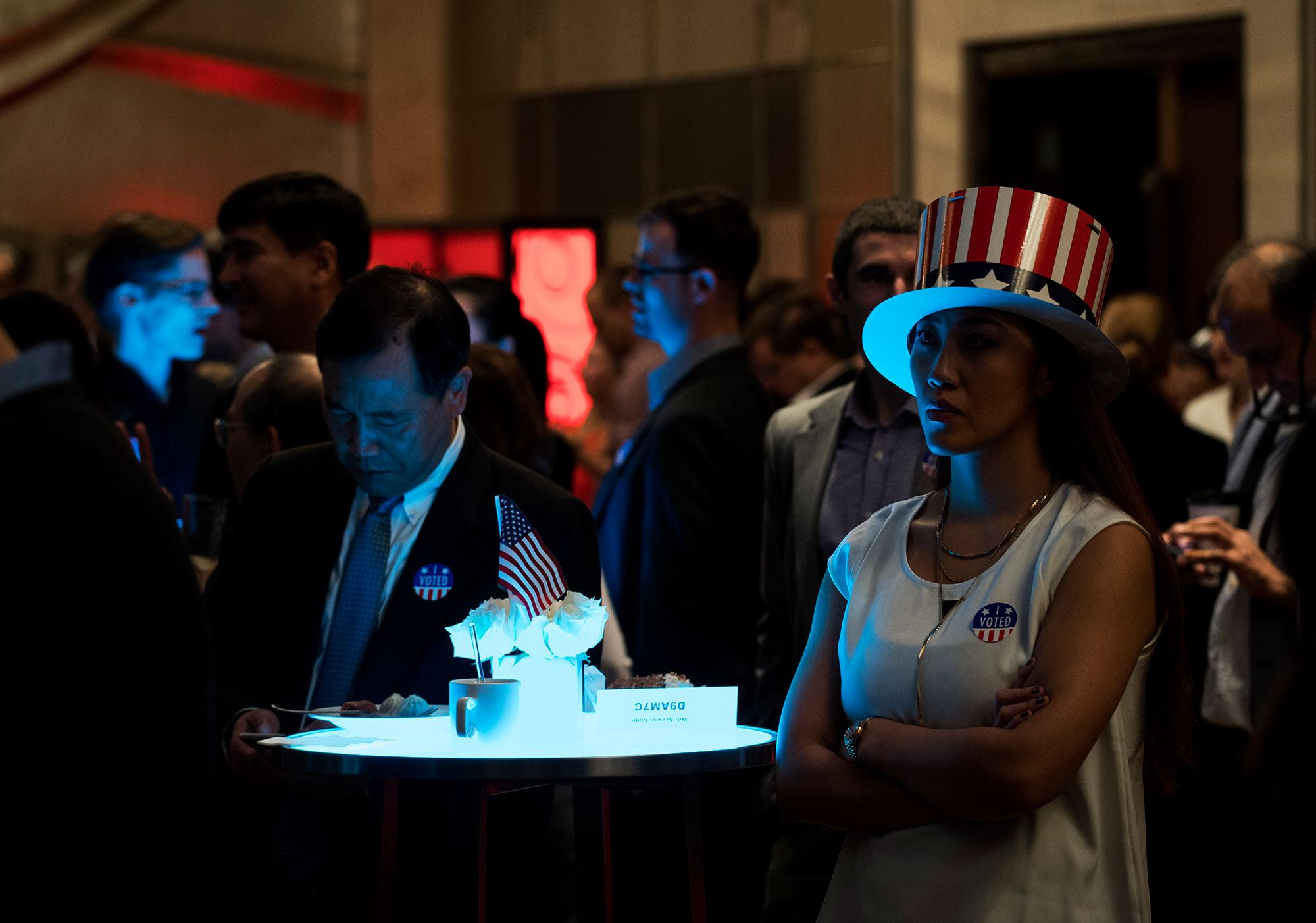 <p>People watch news on a screen to follow the results of the final day of the US presidential election at an event organised by the American consulate in Shanghai on November 9, 2016. (Photo: Johannes Eisele/AFP/Getty Images) </p>