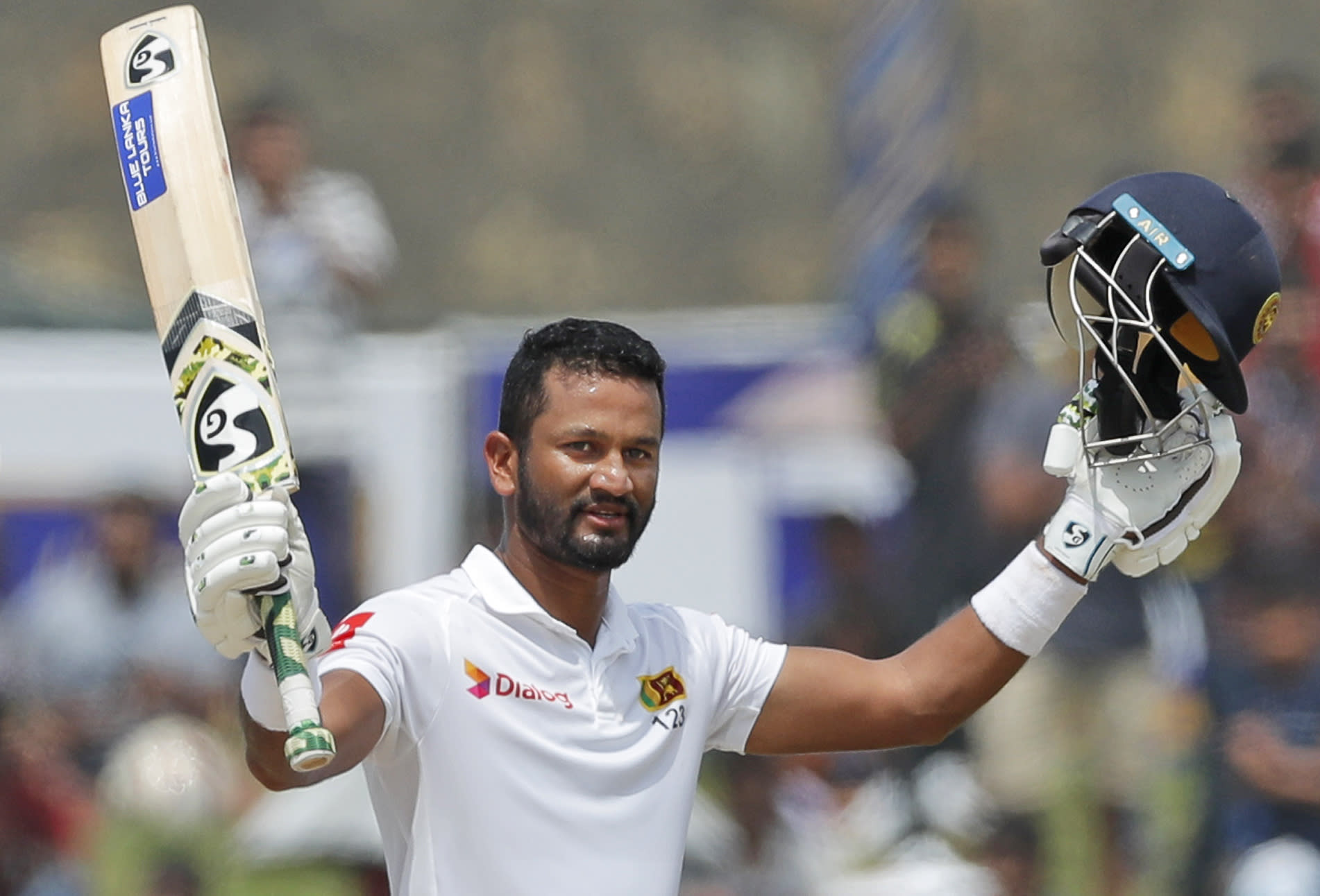 Sri Lankan's Dimuth Karunaratne celebrates scoring a century during the day five of the first test cricket match between Sri Lanka and New Zealand in Galle, Sri Lanka, Sunday, Aug. 18, 2019. (AP Photo/Eranga Jayawardena)