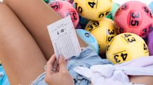 Couple's disbelief after buying TWO winning $1m Lotto tickets