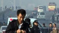 Coordinated explosions near Communist headquarters in China