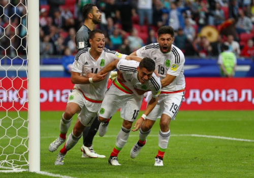 Mexico escaped with a point against Portugal thanks to Hector Moreno (center) and his stoppage-time header. (Getty)