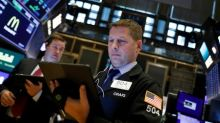 Global Markets: Shares edge up after Fed rate cut, oil prices gain