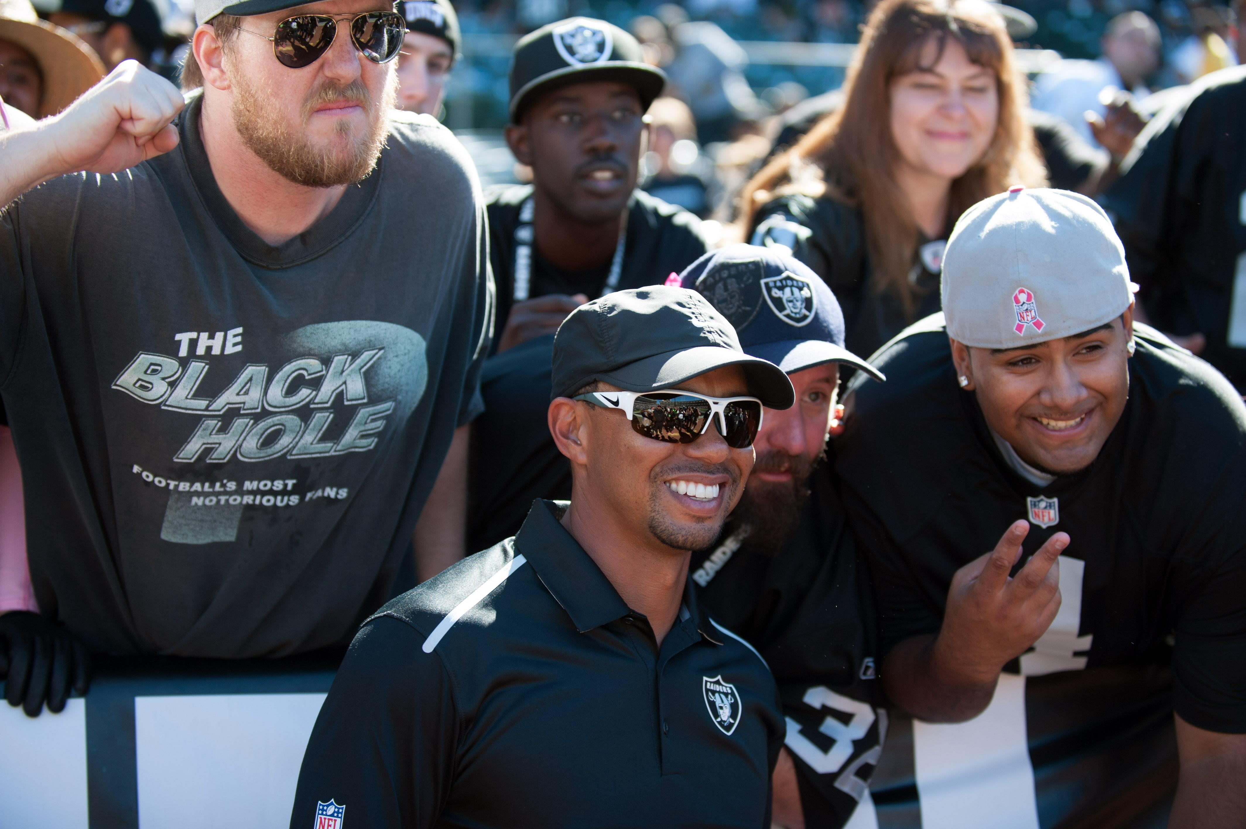 Tiger Woods hangs with Raiders fans during San Diego game