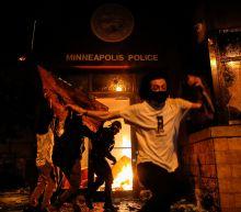 Minneapolis police precinct burns as George Floyd protests rage; CNN crew arrested