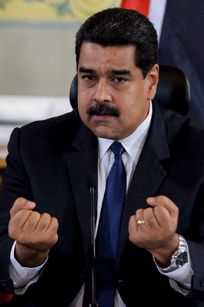 Venezuelan President Nicolas Maduro has been in power since 2013, benefiting from the public backing of the military high command and of most state institutions (AFP Photo/Federico Parra)