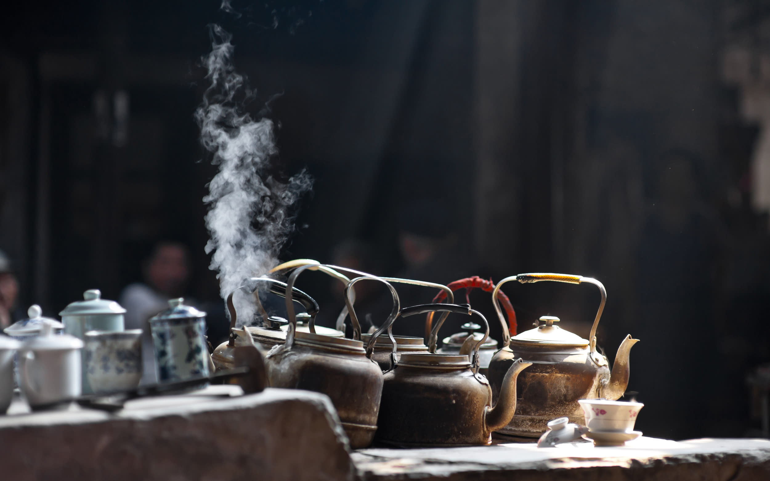 'Kettles on stove in old tea house, Chengdu, China'