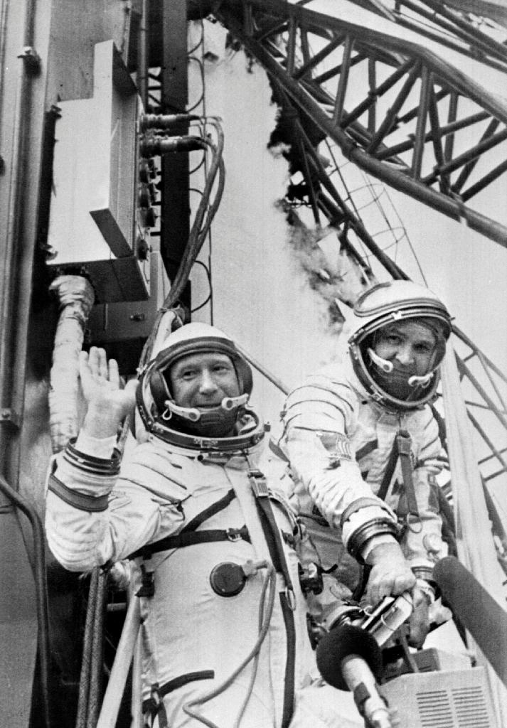 Russian cosmonaut Alexei Leonov (L) and his colleague wave while getting into their spaceship ready to be launched on July 15, 1975 from Baïkonour, Russia, a decade after Leonov's historic first spacewalk (AFP Photo/)