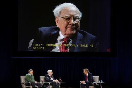 Warren Buffett, chairman and CEO of Berkshire Hathaway, is seen on a video screen as Bill Gates and moderator Charlie Rose (R) listen at Columbia University in New York, U.S., January 27, 2017. REUTERS/Shannon Stapleton