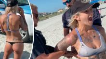 Police handcuff woman over 'skimpy' bikini in shock beach video