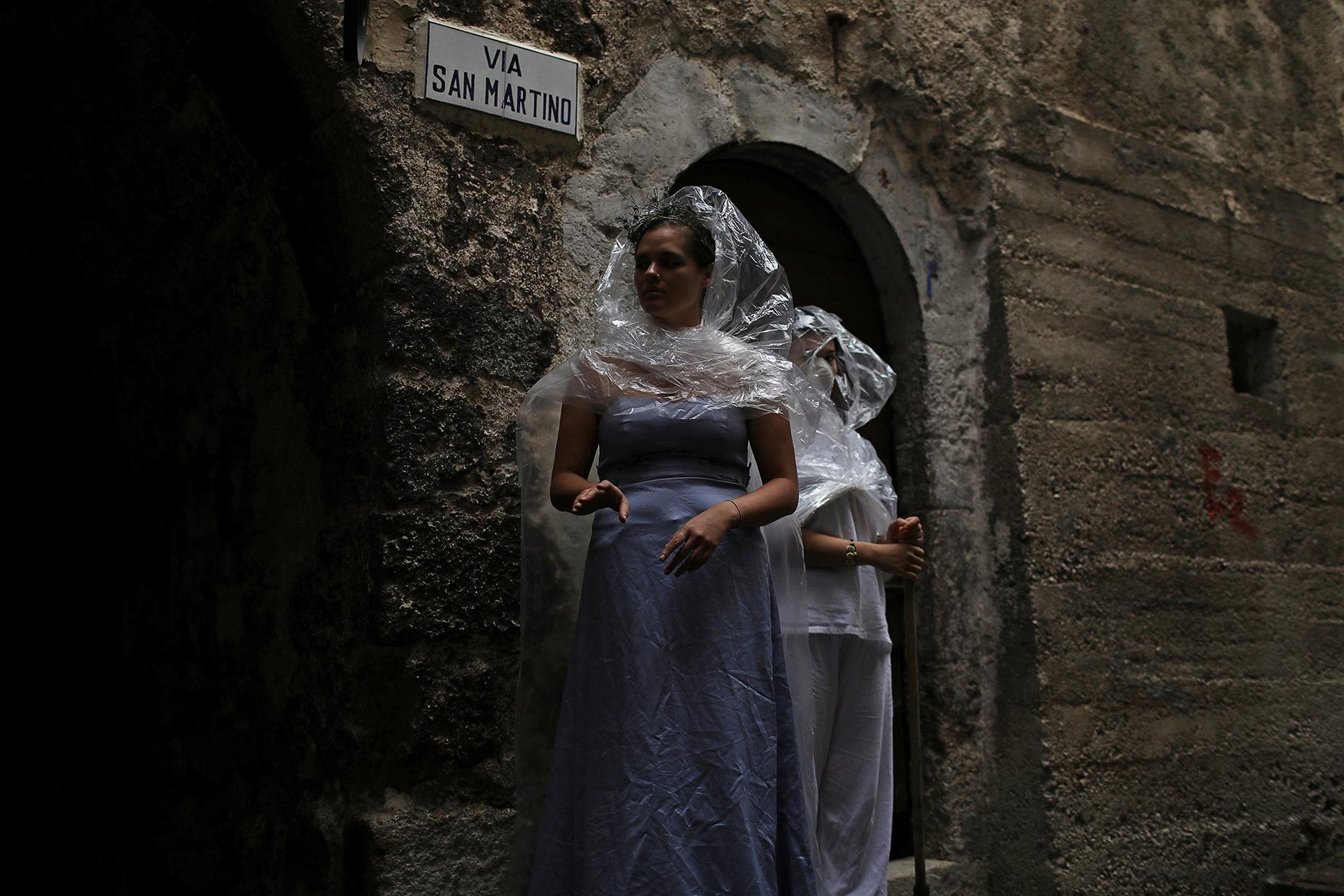 <p>Women wear costumes as part of an art installation in the mostly abandoned old center of the town of Castelvecchio in the province of L'Aquila in Abruzzo, inside the national park of the Gran Sasso e Monti della Laga, Italy, September 11, 2016. (Photo: Siegfried Modola/Reuters) </p>