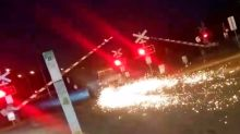 Car towing trailer with no wheels speeds under boom gate in wildpolice chase
