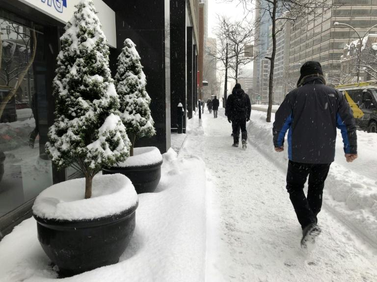 People walk on the Rene-Levesque Boulevard in downtown Montreal in February 2019