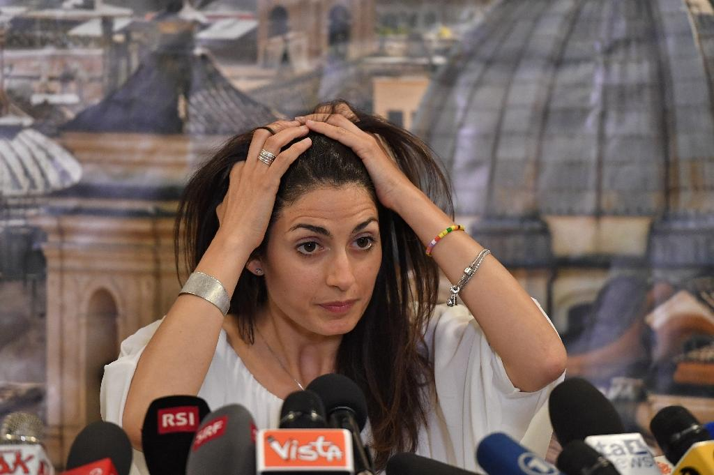 Five Star Movement candidate Virginia Raggi gives a press conference after winning the mayoral election in Rome on June 19, 2016 (AFP Photo/Tiziana Fabi)