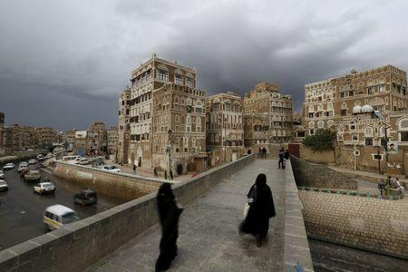 Women walk on a bridge in the old quarter of Yemen's capital Sanaa