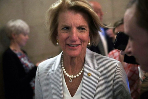 Sen. Shelley Moore Capito (R-WV) is chased by members of the media as she is on her way to view the details of a new health care bill July 13, 2017 at the Capitol in Washington, DC. (Photo: Alex Wong/Getty Images)
