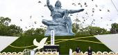 Doves fly over the Statue of Peace on Aug. 9 at Nagasaki Peace Park in Nagasaki, Japan. (Kyodo News via AP)