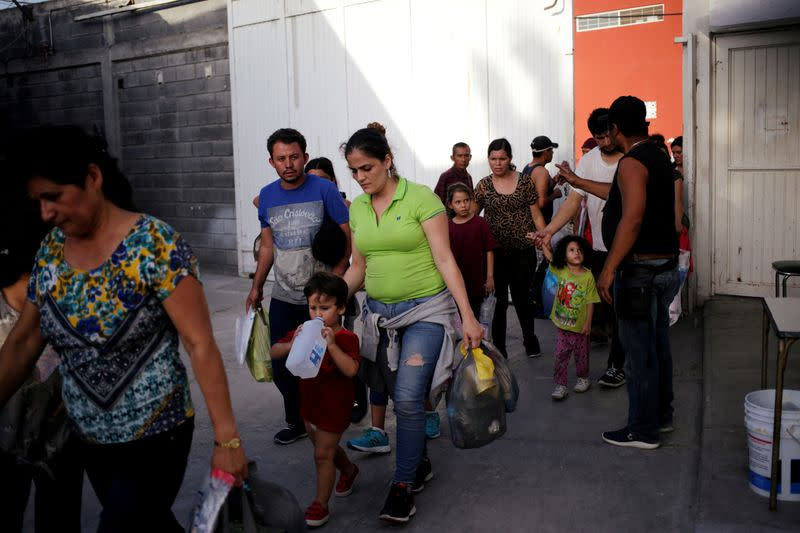 """FILE PHOTO: Central American migrants, returned from the U.S. to Nuevo Laredo in Mexico under the Migrant Protection Protocol to wait for their court hearing for asylum seekers, are seen arriving to the """"Casa INDI"""" migrant shelter in Monterrey"""