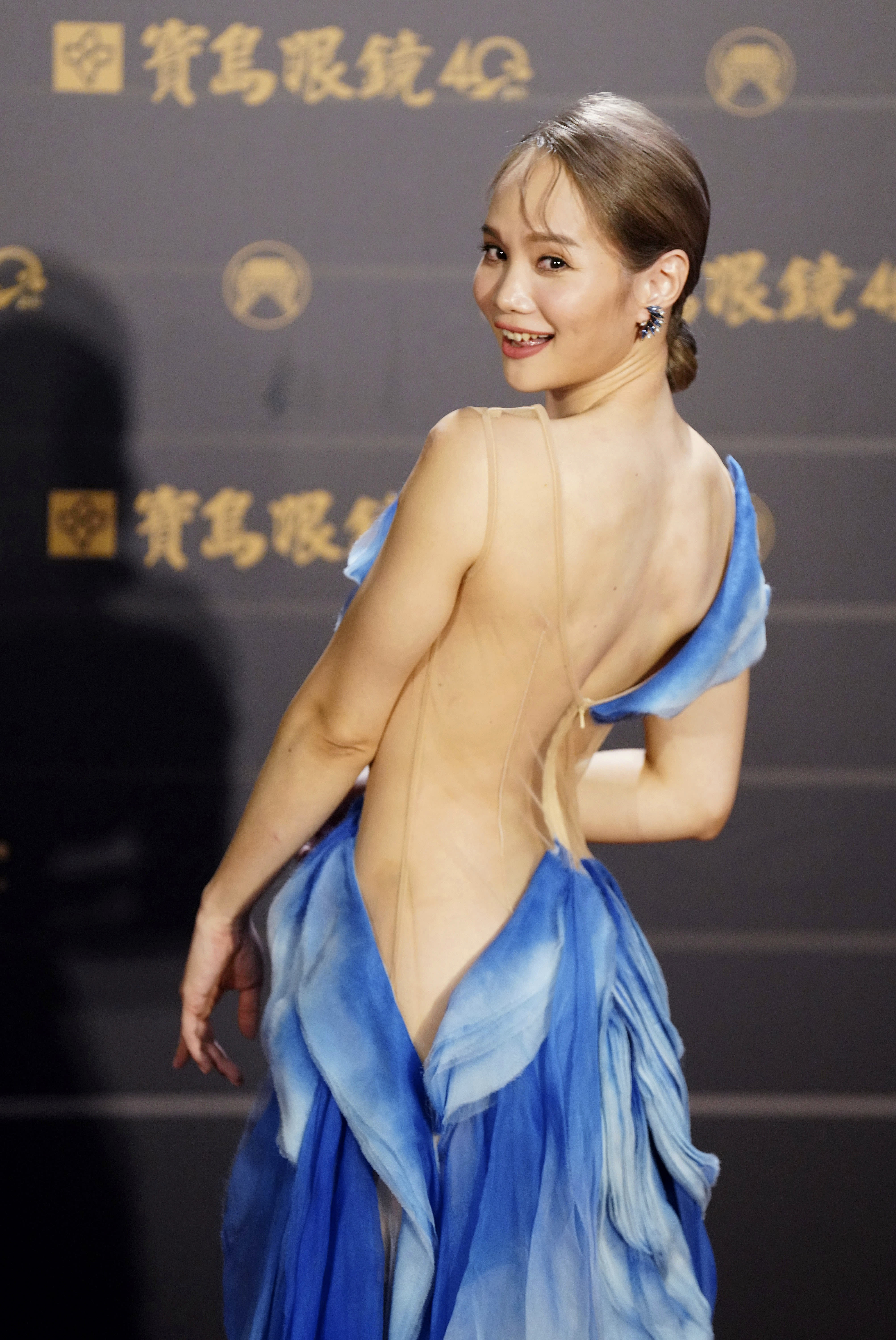 Taiwanese singer Freda Li of pop group ''Murmurshow'' poses as she arrives for the 31th Golden Melody Awards in Taipei, Taiwan, Saturday, Oct. 3, 2020. The awards show, one of the world's biggest Chinese-language pop music annual events was postponed from June to Oct. due to the coronavirus pandemic. (AP Photo/Billy Dai)