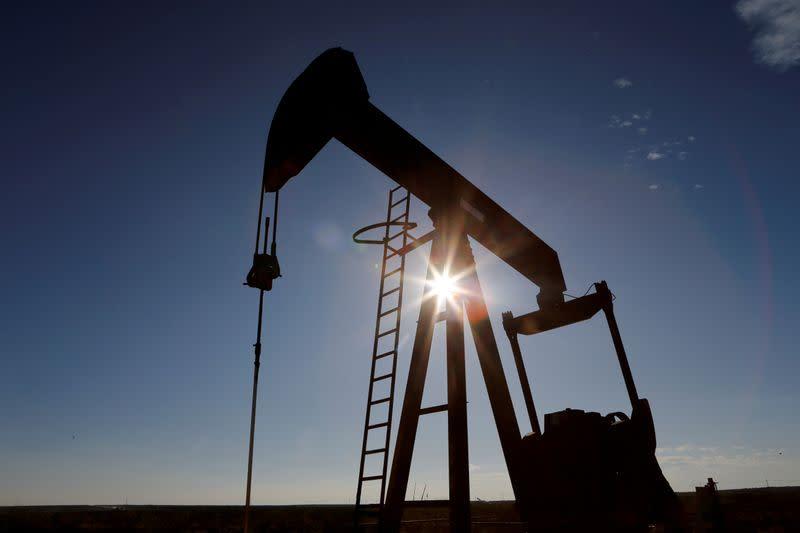 Oil edges up on U.S. Gulf shutdowns, outlook weak