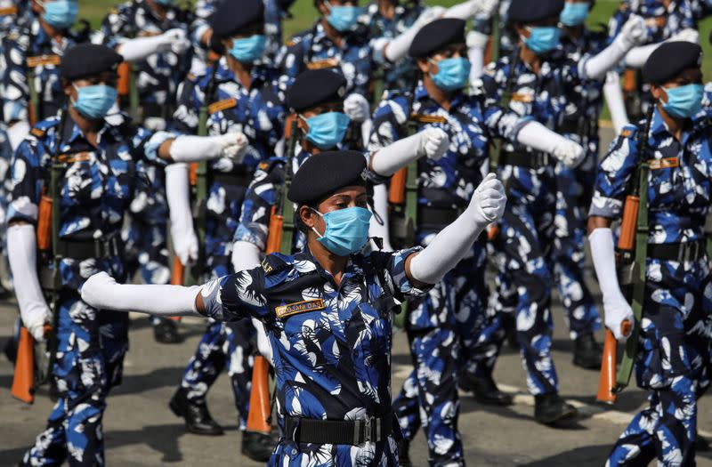 Members of the Rapid Action Force (RAF) of Kolkata police wearing face masks take part in rehearsal for the Independence Day parade, after authorities eased lockdown restrictions that were imposed to slow the spread of the coronavirus disease, in Kolkata