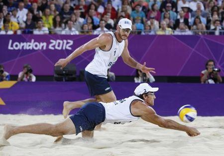 Brazil's Emanuel returns the ball during their men's beach volleyball gold medal match against Germany at the London 2012 Olympic Games