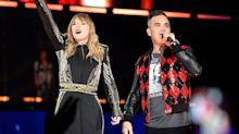 Taylor Swifts brings Robbie Williams on stage at gig