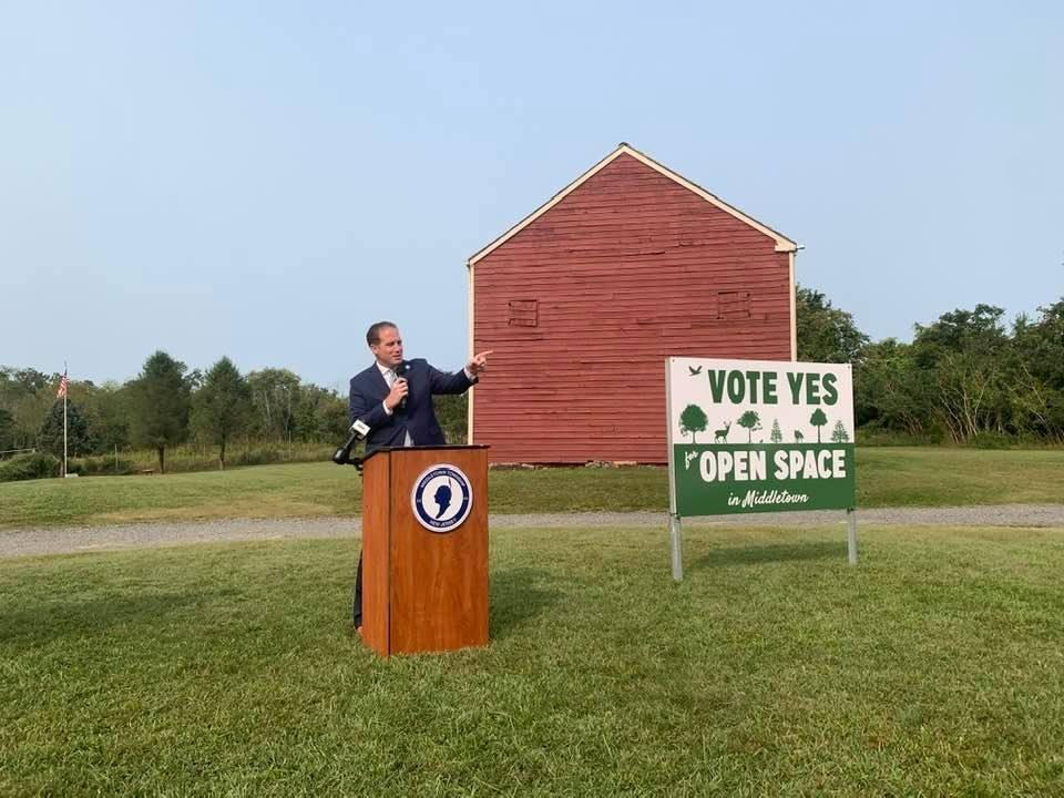 Middletown Mayor Tony Perry speaks in Poricy Park Wednesday. You'll soon see this sign on Tindall Road.