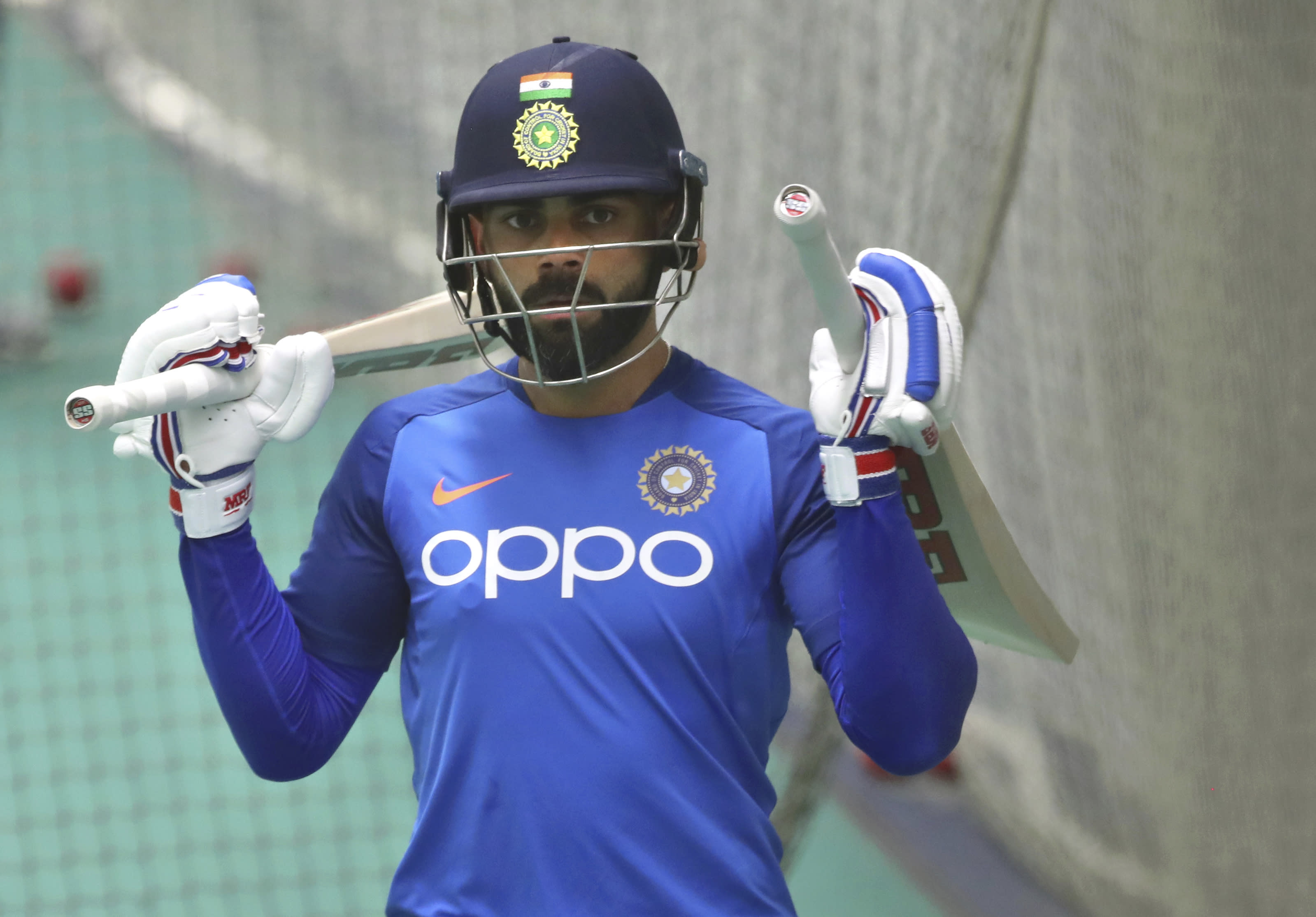 India's captain Virat Kohli leaves after batting in the nets during an indoor training session ahead of their Cricket World Cup match against West Indies at Old Trafford in Manchester, England, Tuesday, June 25, 2019. (AP Photo/Aijaz Rahi)