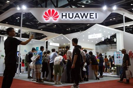 People look at products at the Huawei stall at the International Consumer Electronics Expo in Beijing