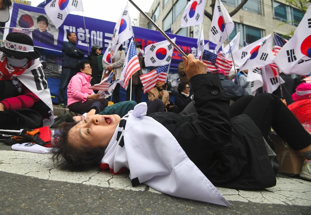 The verdict was greeted with public displays of outrage and grief by Park supporters (AFP Photo/Jung Yeon-je)