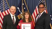 Photo of APS Employees - and U.S. Military Veterans - Paul Rose (Navy), Carmen Sparkman (Army) and Ray Brooks (Marine Corps) Accepting the HIRE Vets Medallion is Available on Business Wire's Website and the Associated Press Photo Network