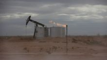 Oil slips on surprise rise in U.S. crude stocks