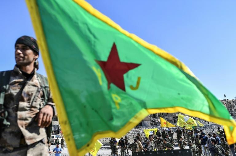 The Syrian Democratic Forces, dominated by the YPG and backed by US special forces, played a key role in ousting the Islamic State group from northern and eastern Syria (AFP Photo/BULENT KILIC)
