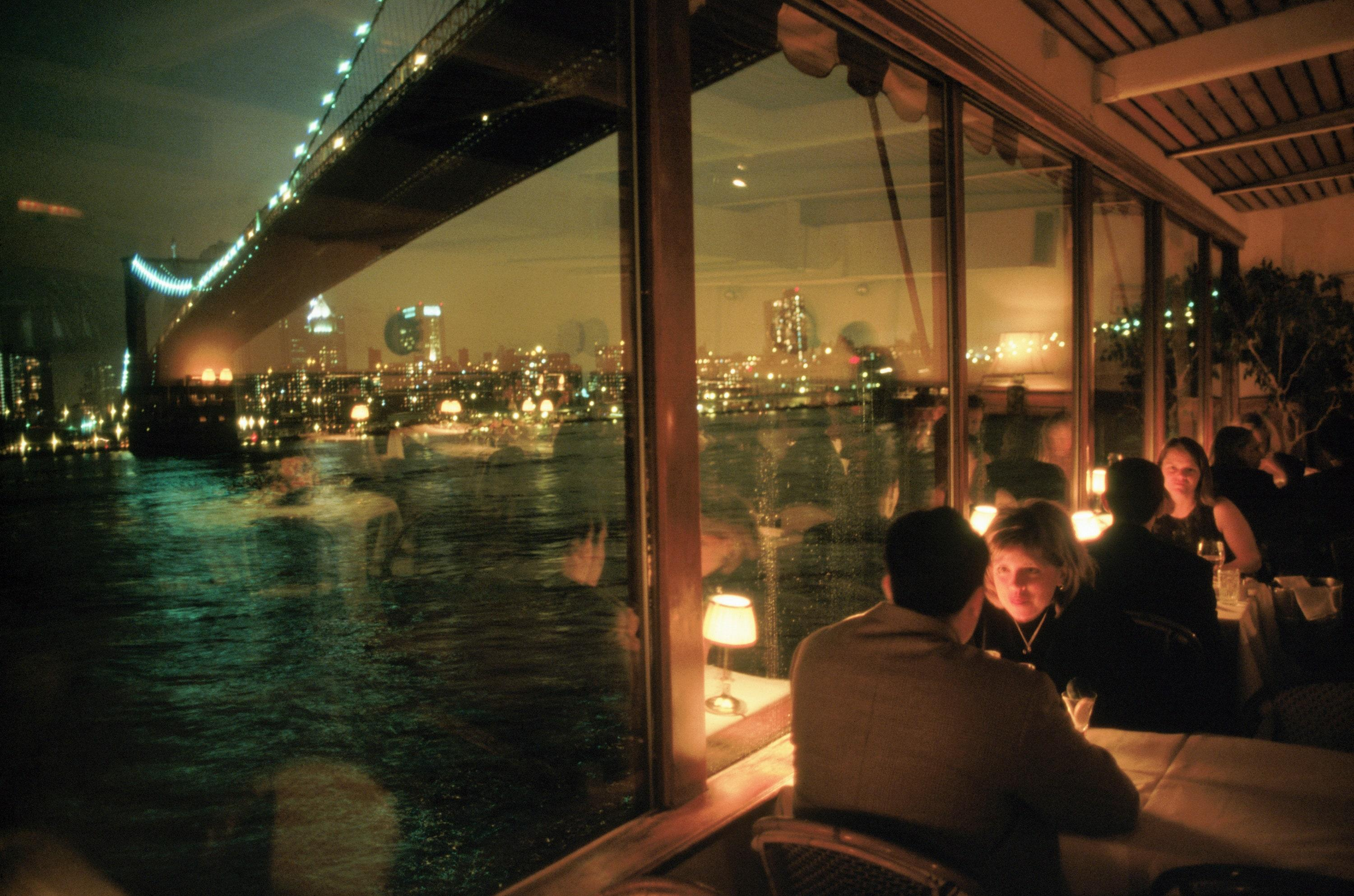 """Tucked away under the iconic Brooklyn Bridge, The River Café is a must-visit for anyone in search of a great meal paired with stunning views. Both day and night, the floor-to-ceiling windows allow diners to take in the length of the Brooklyn Bridge, the serenity of the East River, and the majesty of lower Manhattan. <em>1 Water St, Brooklyn, New York;</em> <a href=""""https://rivercafe.com/"""" rel=""""nofollow noopener"""" target=""""_blank"""" data-ylk=""""slk:rivercafe.com"""" class=""""link rapid-noclick-resp""""><em>rivercafe.com</em></a>"""