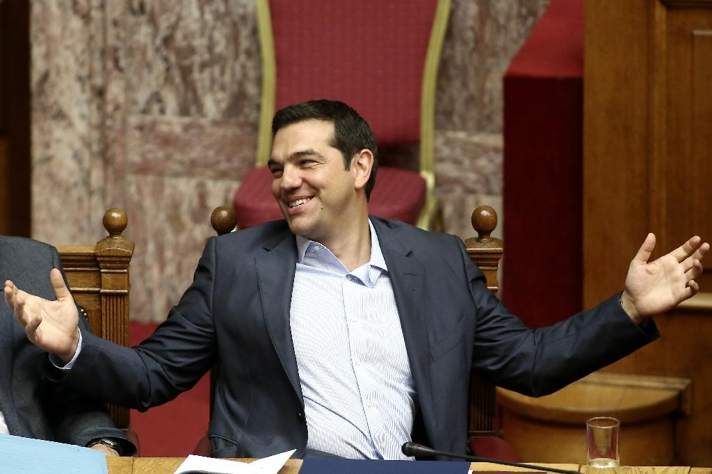 Tsipras reacts during an overnight parliamentary debate in Athens on August 14, 2015, hours ahead of a critical meeting by European finance ministers (AFP Photo/Panayiotis Tzamaros)