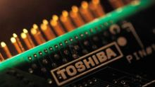Toshiba sees annual loss of almost $1 billion after tax related to chip unit sale