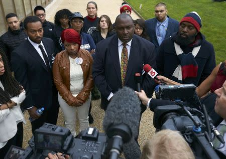 The mother Lesley McSpadden (2nd L) and father Michael Brown Sr. (R) of slain teenager Michael Brown, address the media with their lawyer lawyer Darryl Parks (2nd R) after a news conference in Geneva November 12, 2014. REUTERS/Denis Balibouse
