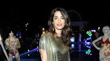 Amal Clooney looks gorgeous in gold at vintage Versace event
