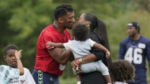 Russell Wilson and Ciara's son Win takes first steps while attending Seahawks practice